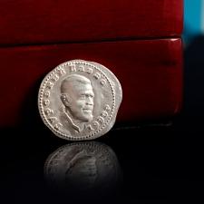 Серебряная монета с Объемным портретом