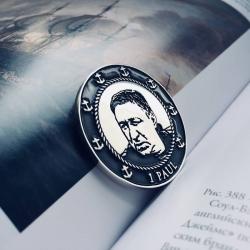 Монета с портретом в морском стиле