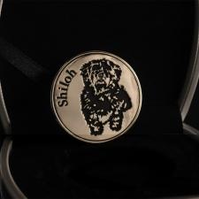Монета с изображением собачки