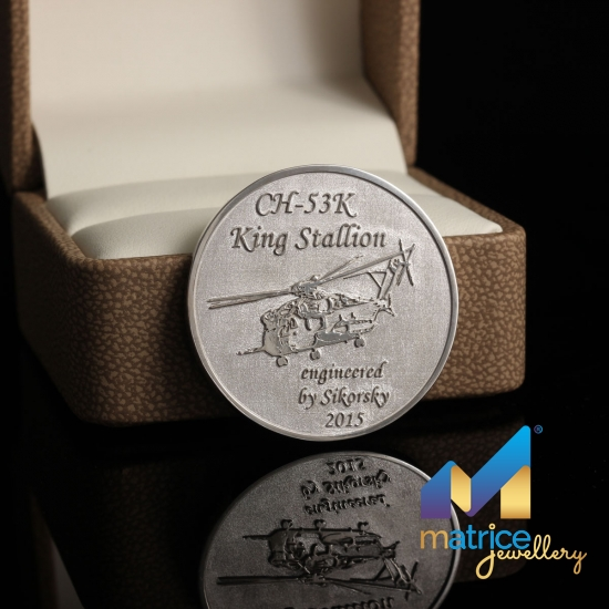 Серебряная монета с вертолётом